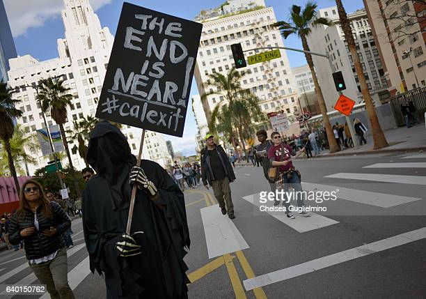 A participant holds a 'Calexit' sign during the Women's March on January 21 2017 in Los Angeles California Tens of thousands of people took to the...