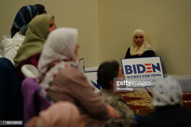 A participant holds a campaign sign for former US Vice President Joe Biden 2020 Democratic presidential candidate during the firstinthenation Iowa...
