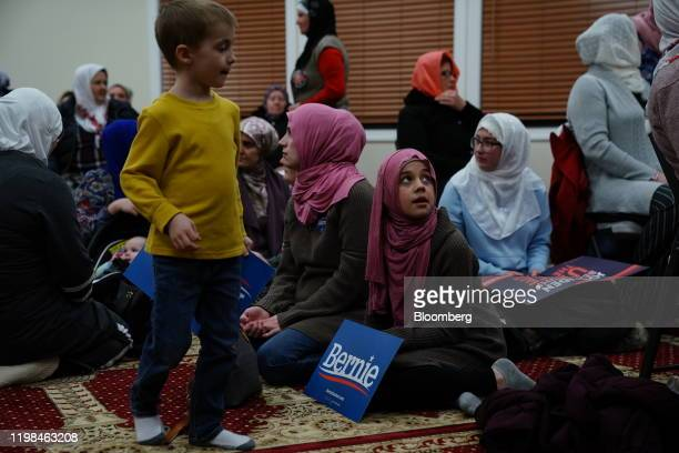A participant holds a campaign sign for Senator Bernie Sanders an Independent from Vermont and 2020 presidential candidate during the...