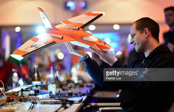 A participant holds a new drone that will one day replace weather balloons at the annual Chaos Communication Congress on December 28 2013 in Hamburg...