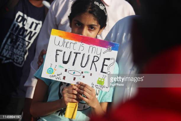 Participant holds a placards as she takes part in a rally against climate change in Mumbai, India on 24 May 2019. As they have joined a global...