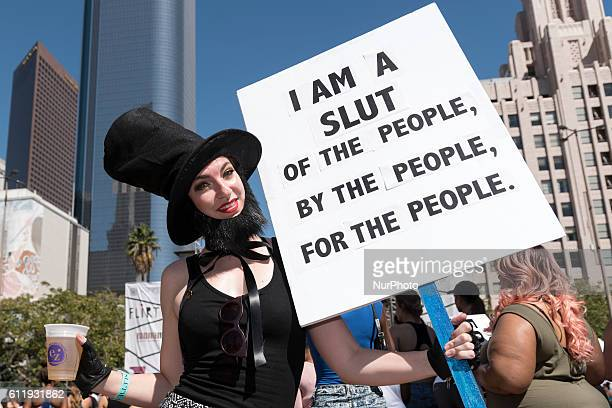 A participant holds a sign during the 2nd Annual Amber Rose SlutWalk Festival in Los Angeles California October 1 2016 The event seeks to bring to an...