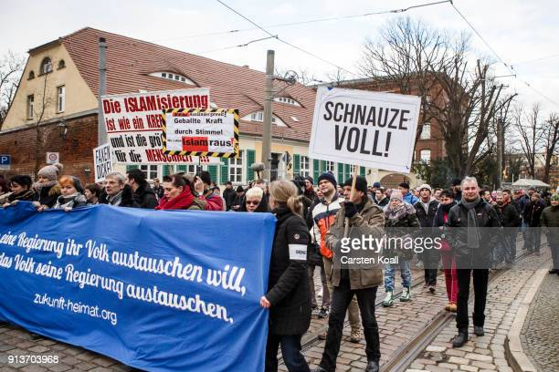 A participant holds a sign 'I'm fed up' in an event organized by the rightwing group 'Zukunft Heimat' gather to protest against the high number of...