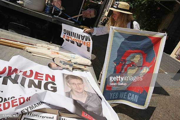 A participant holds a sign in support of former NSA employee Edward Snowden prior to a protest march in support of Snowden Bradley Manning and...