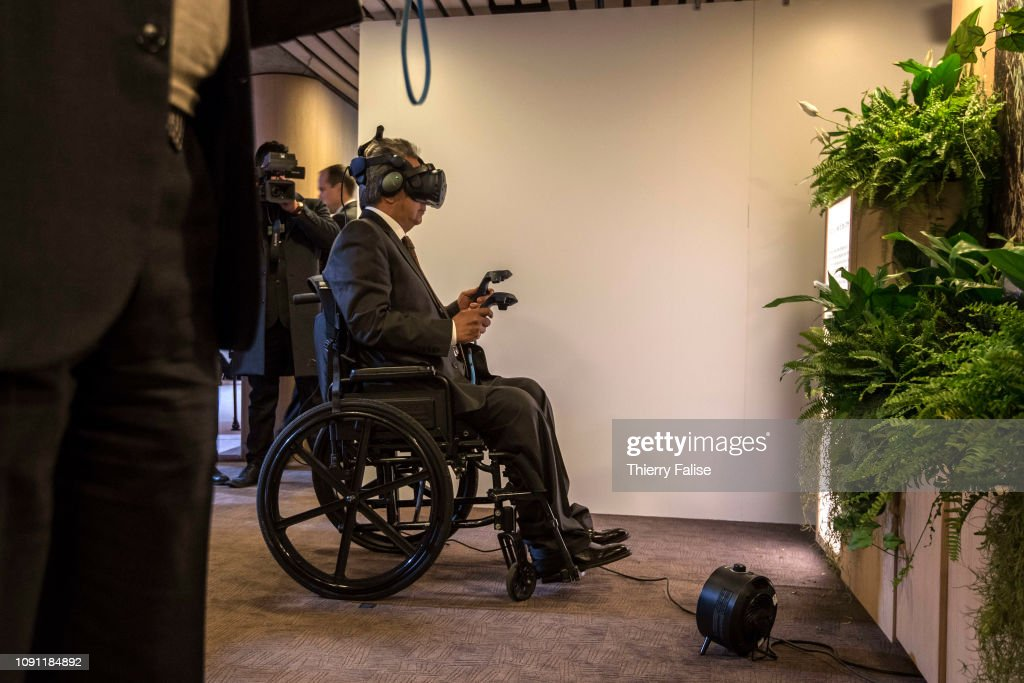 A participant in a wheelchair tests the Tree VR at the 2019 World
