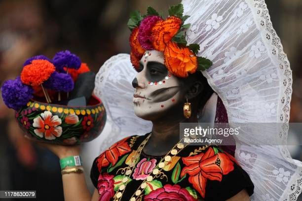 Participant in costume performs during the annual International Day of the Dead Parade in Mexico City Mexico on October 27 2019 The idea for the...