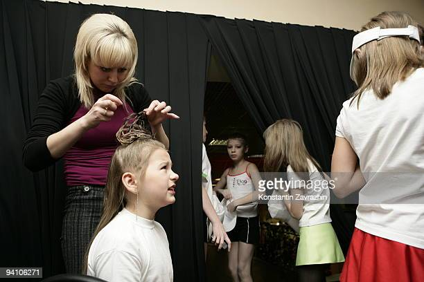 Participant in 'Miss Perfection' an Internationanal children's beauty pagent preparing for the final performance on December 6 2009 in Moscow Russia...