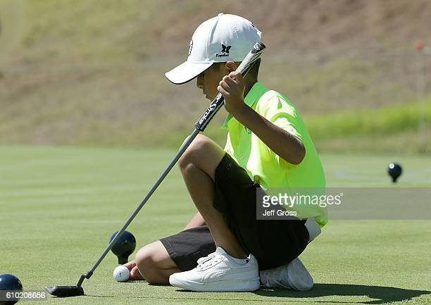 A participant in the boys 79 division lines up a putt in the putting competition during a regional round of the Drive Chip and Putt Championship at...