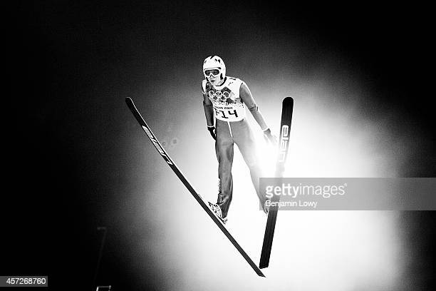 Participant in the Ladies' Normal Hill Individual first round on day 4 of the Sochi 2014 Winter Olympics at the RusSki Gorki Ski Jumping Center on...