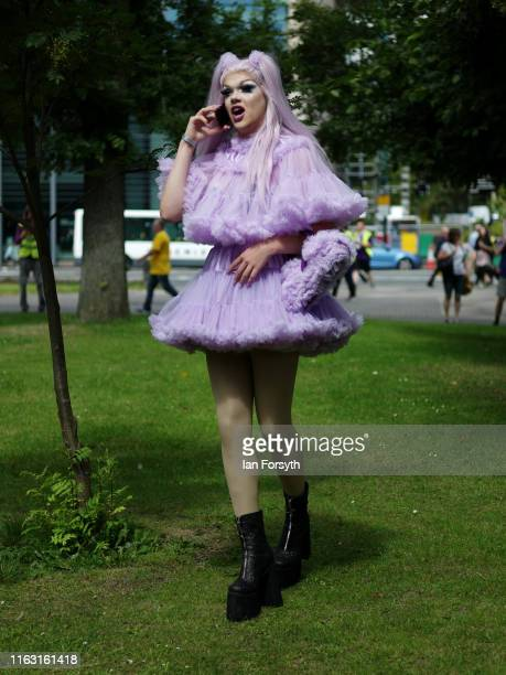 Participant in the Newcastle Pride Festival parade speaks on her phone on July 20, 2019 in Newcastle upon Tyne, England. To commemorate 50 years...