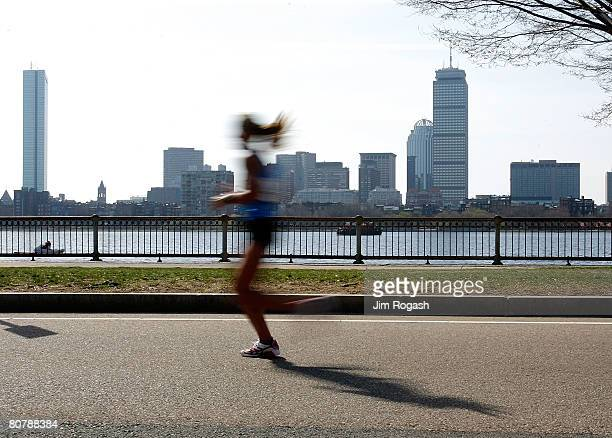 A participant in the US Women's Olympic Marathon Trials run along the Charles River April 20 2008 in Cambridge Massachusetts