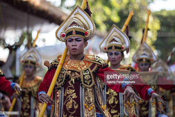 Participant in traditional dancer costumes walk during a parade of the opening 37th Bali International Arts Festival on June 13 2015 in Denpasar Bali...