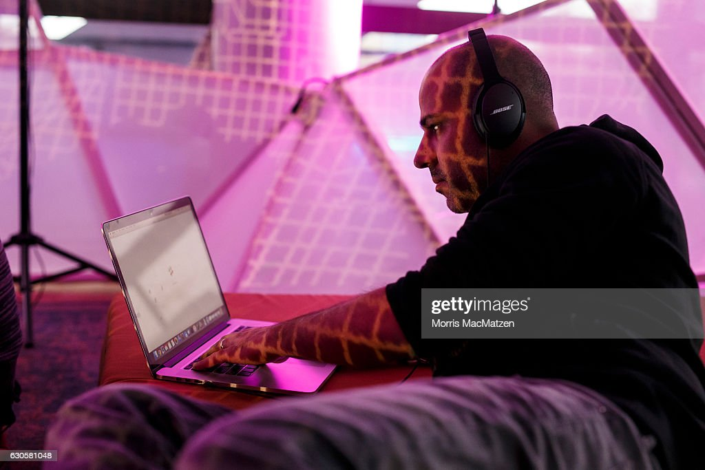A participant is working on his laptop during the 33rd Chaos Communication Congress on its opening day on December 27, 2016 in Hamburg, Germany. The annual event is bringing together 12,000 computer hackers and activists who will meet over the next four days to share expertise and discuss topics related to the society and the digital world.