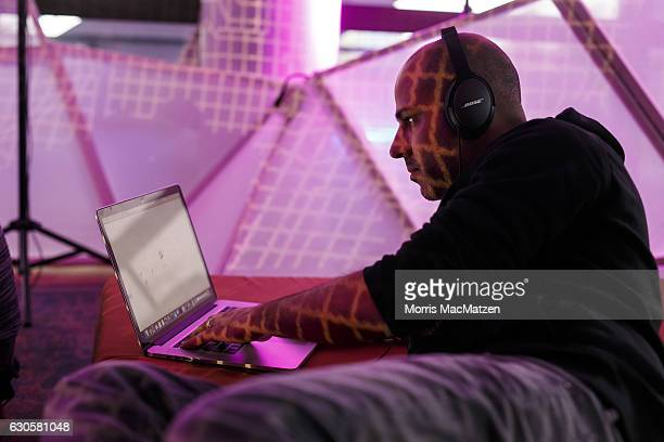 A participant is working on his laptop during the 33rd Chaos Communication Congress on its opening day on December 27 2016 in Hamburg Germany The...