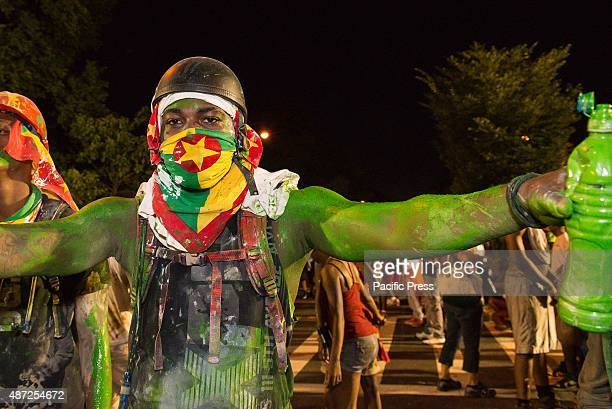 A participant joins during the West Indian Day Parade with body paints Thousands of revelers took to the streets of Crown Heights beginning around...