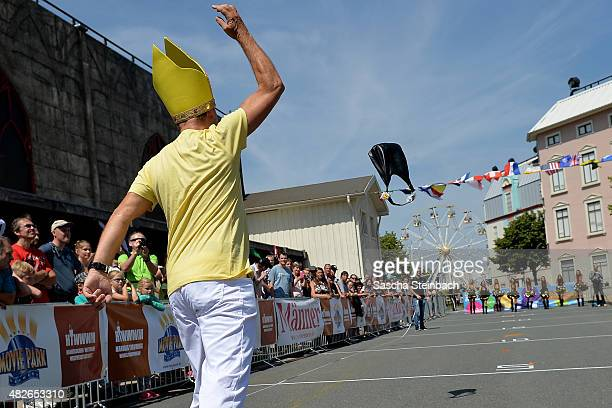 A participant launches a handbag in the 4th annual World Handbag Throwing Championships at Movie Park Germany on August 1 2015 in Bottrop Germany...