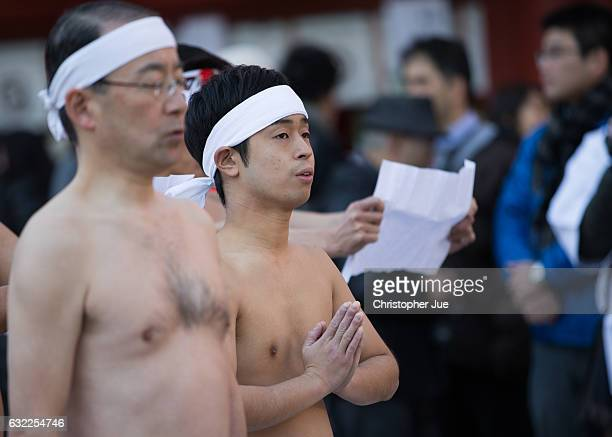 A participant meditates prior to the start of the ice water winter purification ceremony on January 21 2017 in Tokyo Japan At Daikoku Matsuri...