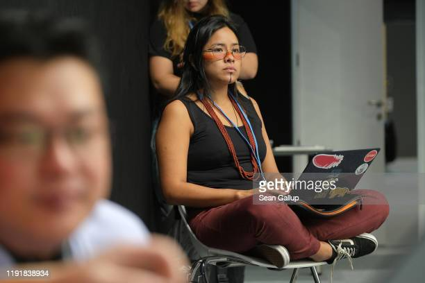 Participant observes a meeting of indigenous peoples organizations on day three at the UNFCCC COP25 climate conference on December 4, 2019 in Madrid,...