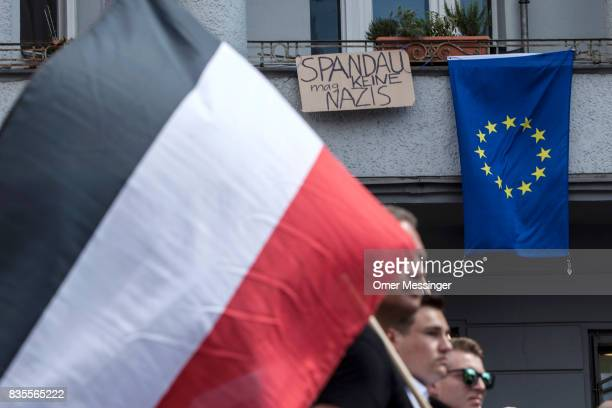Participant of a NeoNazi march pass by the European flag and a sign saying 'Spandau Doesn't Like Nazis' on August 19 2017 in Berlin Germany Some 1000...