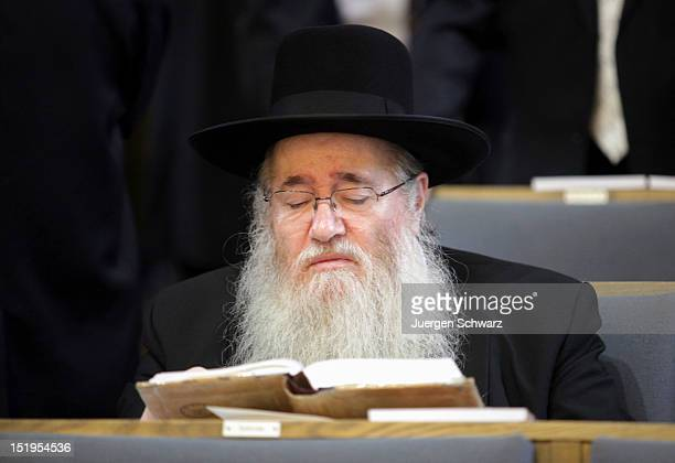 A participant of a rabbi ordination ceremony reads a book at the Synagogue Community Centre on September 13 2012 in Cologne Germany Jewish leaders...