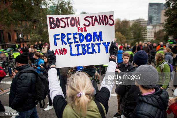 A participant of an AltRight organized free speech event holds a sign that says Boston Stands For Freedom And Liberty across from the Massachusetts...