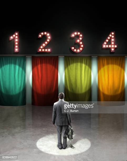 Participant of television show looking at four gates