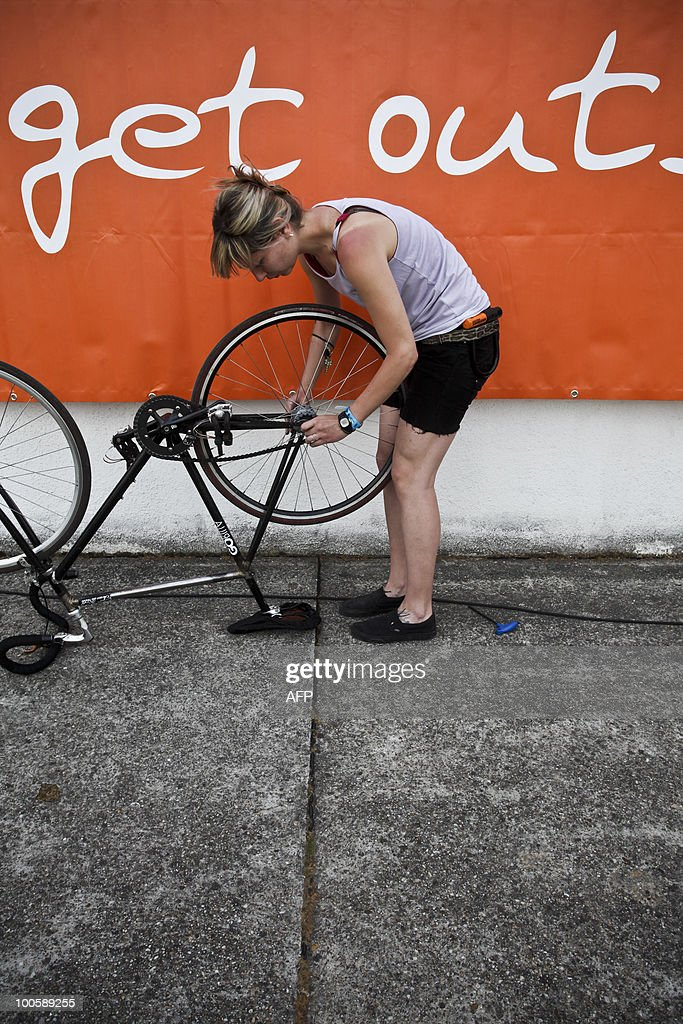 Participant of the 15th European Cyclist Messenger Chanpionships prepares her cycle at Millenaris Velodrome in Budapest on May 22, 2010 during a three-day competition for the best European cycle messengers. Messenger Championships is an urban competition for bike messengers. Once in a year, European messengers converge to decide who are the fastest, smartest and trickiest messengers of that year.