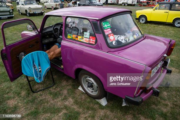 A participant of the annual meeting of the Trabant fans lies in a Trabant on August 24 2019 in Zwickau Germany The humble Trabant or Trabi as many...