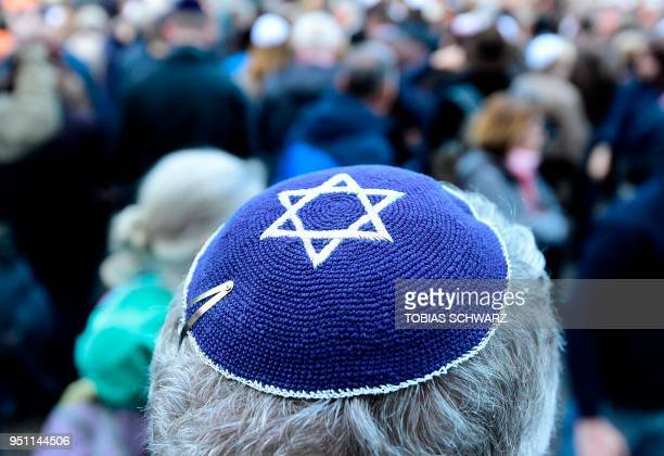 A participant of the Berlin wears kippa rally wears a kippa in Berlin on April 25 2018 Germans stage shows of solidarity with Jews after a spate of...