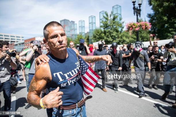 A participant of the Boston Straight Pride Parade is pushed away from counter protesters after an altercation on August 31 2019 in Boston...