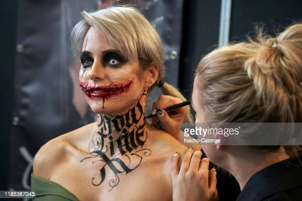 A participant of the event makes up one of her models in the course the International Tattoo Convention on October 25 2019 in Amsterdam Netherlands...