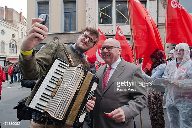Participant of the mayday march in Ghent takes a selfie with Daniël Termont, mayor of Ghent.