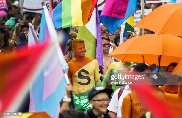 A participant of the parade has an 'S' written on his body in Frankfurt am Main Germany 15 July 2017 Thousands of lesbians and gays take the streets...