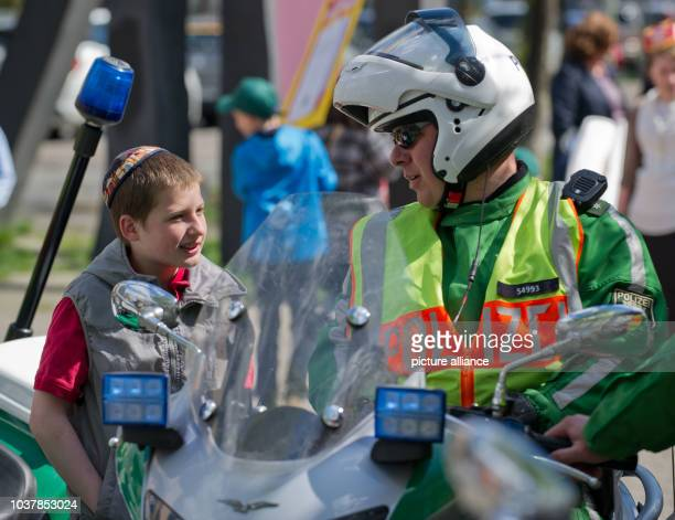 A participant of the parade 'Lag Baomer' talks to a police officer in Berlin Germany 28 April 2013 The Jewish holiday is celebrated to call for more...
