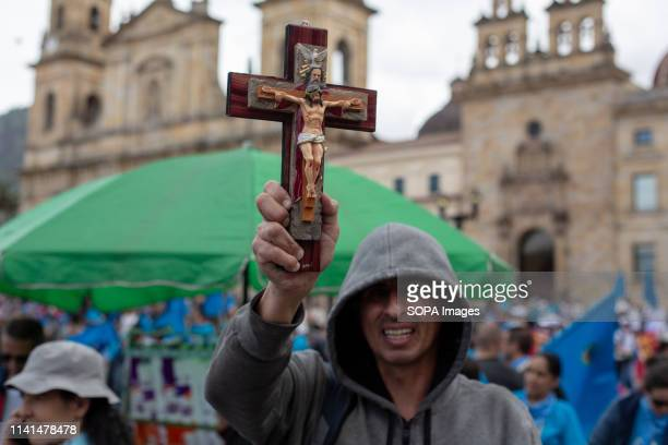 BOLíVAR BOGOTá CUNDINAMARCA COLOMBIA A participant of the pro life movement holds a cross during the Unidos por la vida Pro life rally in Bogota...