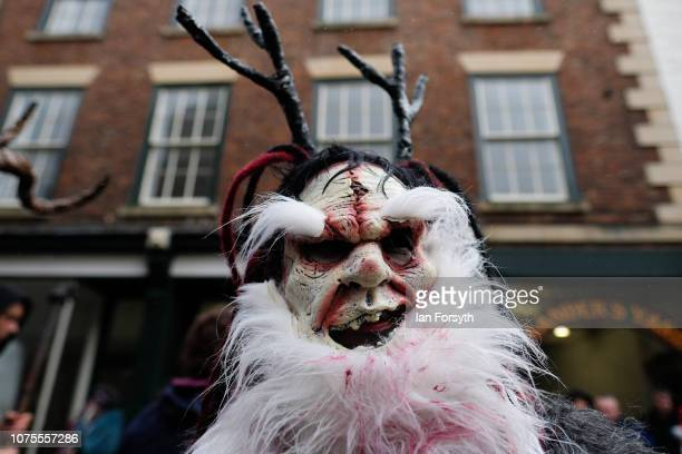 A participant parades through the streets during the annual Whitby Krampus parade on December 01 2018 in Whitby England The Krampus is a horned...