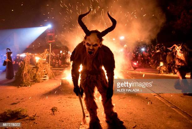A participant performs during a procession of 'Krampus' monsters in Schwadorf Austria on November 24 2017 Krampus is traditionally the evil sidekick...
