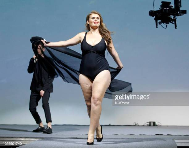 A participant performs on the stage during the quotMiss Ukraine Plus Size 2018quot beauty contest in Kiev Ukraine on 29 October 2018 The competition...