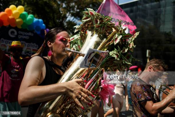 A participant plays a tuba at the 40th Christopher Street Day gay pride march on July 28 2018 in Berlin Germany Known as CSD the event attracts...