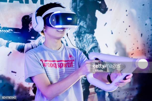 Participant plays video games by using a Playstation VR headset during the 19th Ani-Com and Games Fair 2017 at the Hong Kong Convention and...