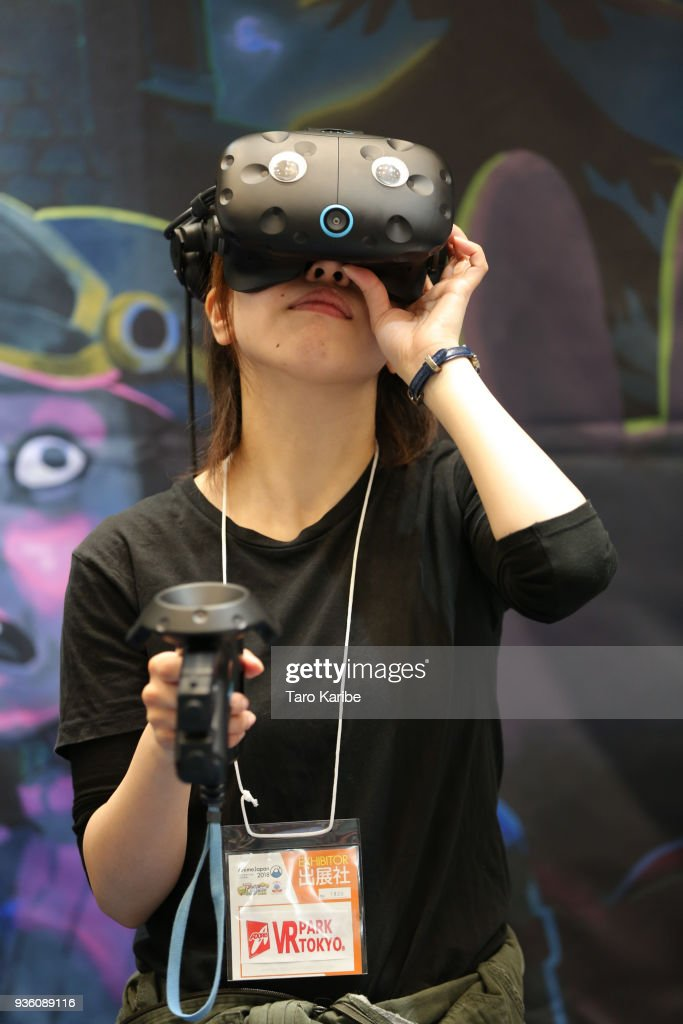 A participant plays VR game during the AnimeJapan 2018 at Tokyo Big