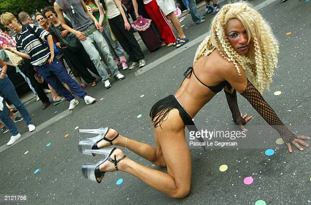 A participant poses at the Gay Pride parade June 28 2003 in Paris Up to 700000 people marched in a parade organized by the gay lesbian and...