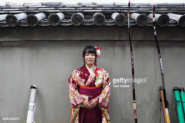 A participant poses during an archery event for 20yearolds to celebrate her comingofage at Sanjusangendo Temple on January 17 2016 in Kyoto Japan...