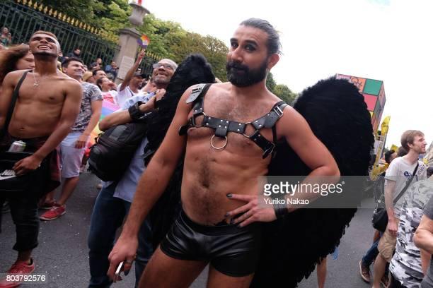 A participant poses during the Paris Gay Pride Parade or known as Marche des Fiertés LGBT in France on June 24 2017 in Paris France