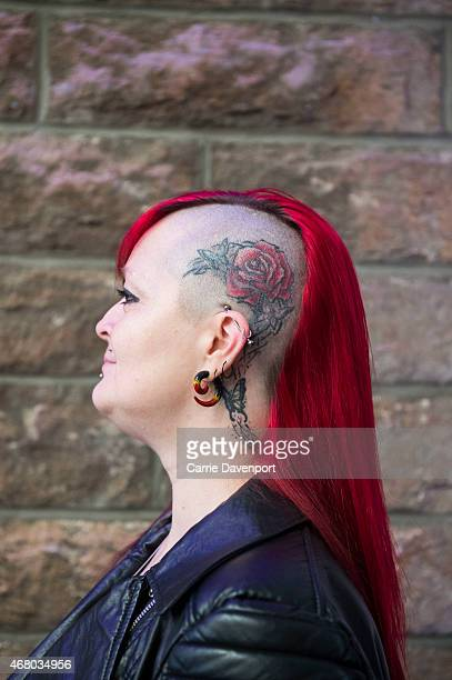 A participant poses during the Scottish Tattoo Convention on March 29 2015 in Edinburgh Scotland