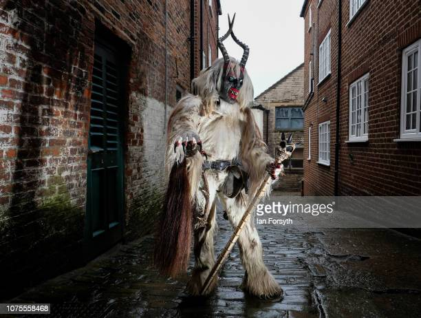 A participant poses for a photograph ahead of a parade through the streets during the annual Whitby Krampus parade on December 01 2018 in Whitby...