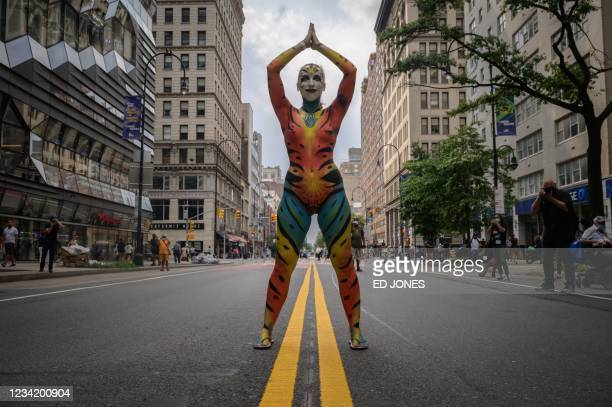 Participant poses for photos on a road during the annual NYC Bodypainting Day near Union Square in New York on July 25, 2021. - The annual...