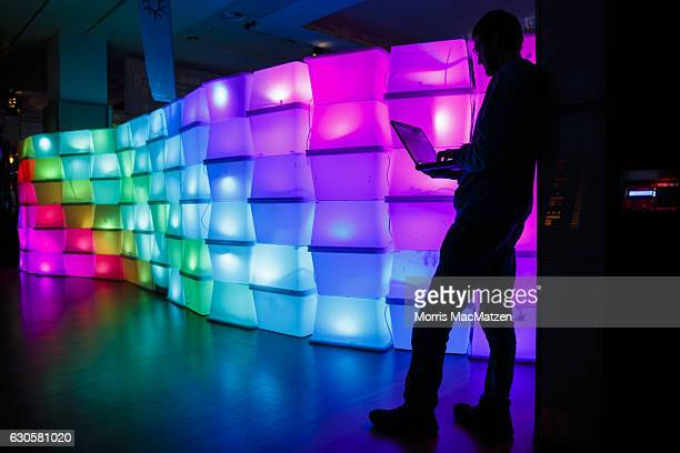 A participant poses in front of a LEDWall during the 33rd Chaos Communication Congress on its opening day on December 27 2016 in Hamburg Germany The...
