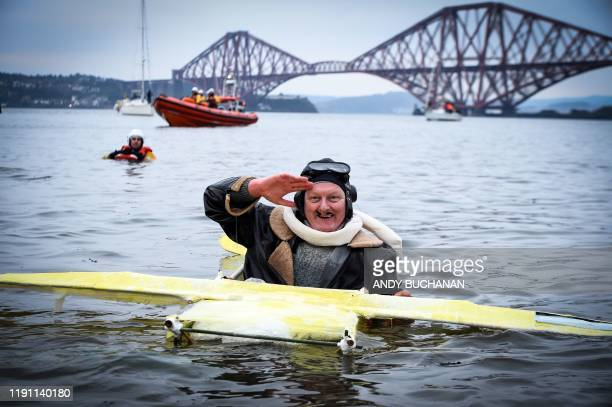A participant poses in the water as he takes part in the annual New Year's Day Loony Dook swim in the Firth of Forth in South Queensferry near...