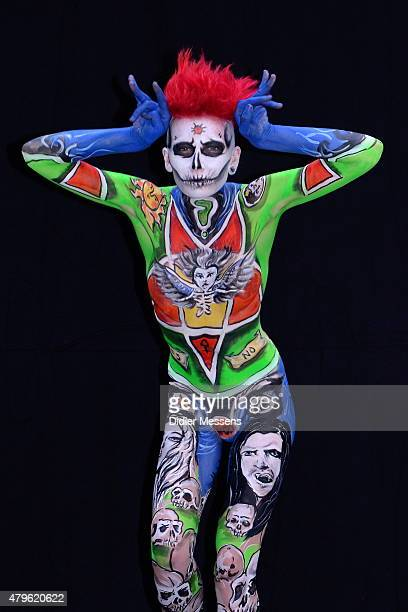A participant poses with her body paintings designed by bodypainting artist Maria Cribben from Ireland in the 2015 World Bodypainting Festival on...